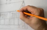 Søren tegner med blyant